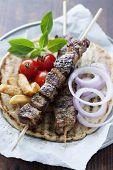 greek style pita bread with meat skewers (souvlaki) poster