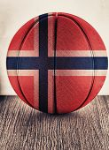 Close up of an old leather basketball with Norway flag poster