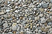 Many smooth pebbles and stones texture background. poster
