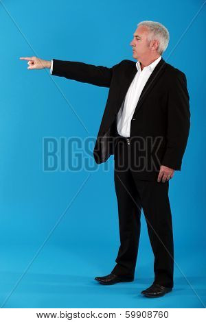 Senior man pointing to the front