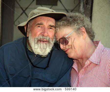 Elderly Couple On A Porch