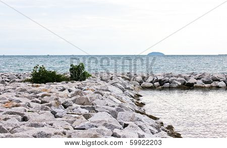 Breakwall Rocks At Sea Coast In Thailand.