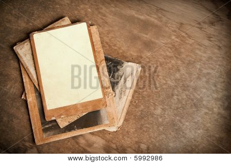 Vintage photo frames, retro pictures on old wooden background.