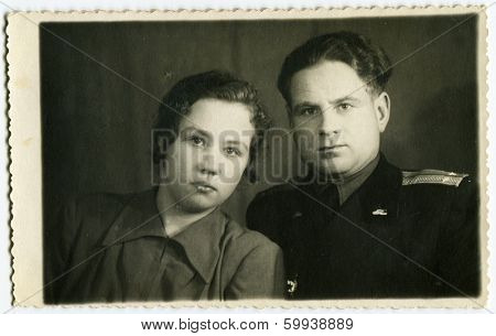 KURSK, USSR - CIRCA 1960s:  An antique photo shows  portrait of a Soviet officer and his wife.