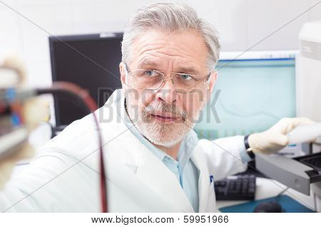 Life science researcher performing a genotyping testing which enables personalized medicine. PM is a medical model that proposes the customization of healthcare. poster