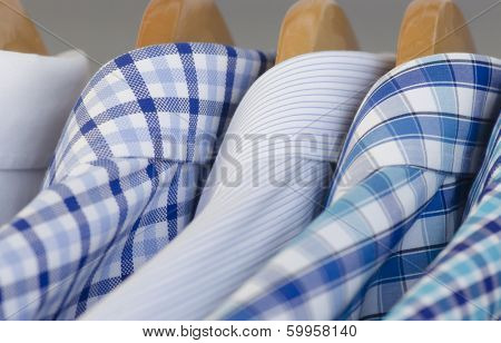 Closeup photo of Mens's dress shirts hanging.