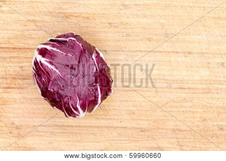 Red Radicchio On A Bamboo Board