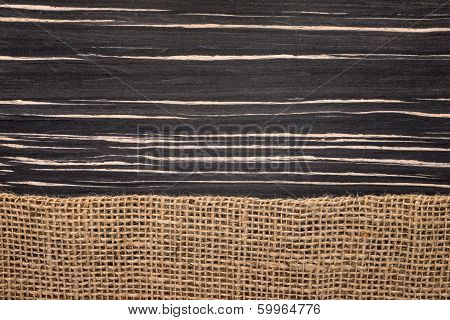 rough sack material and a wooden texture of zebrano poster