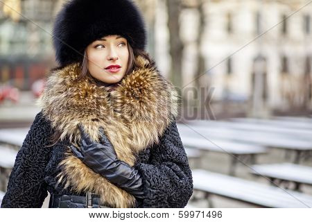 Winter girl posing in park