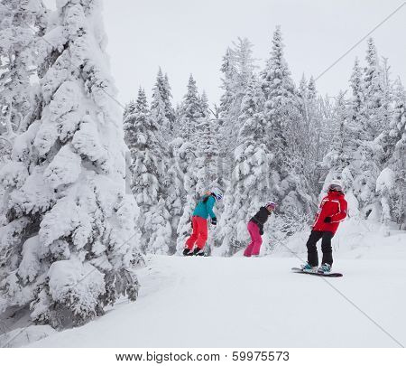 MONT-TREMBLANT, QC, CANADA -FEBRUARY 9: Snowboarders are sliding down an easy slope at Mont-Tremblant Ski Resort on February 9, 2014. It is the best ski resort in Eastern North America.