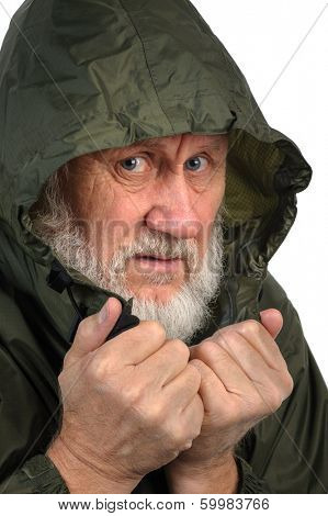 pathetic senior man in green waterproof hoody
