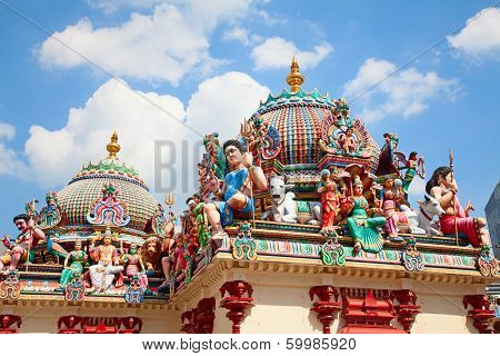 Fragment of decorations of the Hindu temple Sri Mariamman in Singapore poster