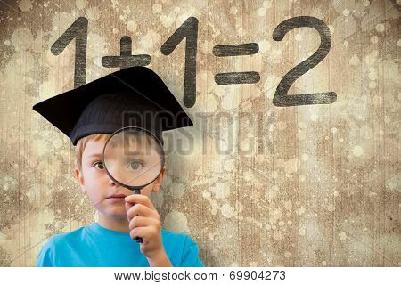 Cute pupil looking through magnifying glass against wooden surface with planks poster