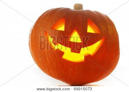 Funny Jack O Lantern halloween pumpkin with candle light inside isolated on white background