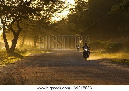 RAYONG THAILAND-AUGUST 11 : unidentified people riding motorcycle along dusty road in undevelopment