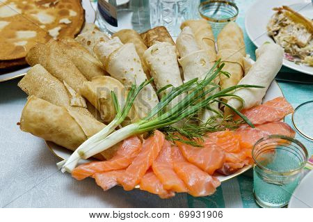Pancakes With Salmon Slices And Green Onion (Russian Cuisine Dish)