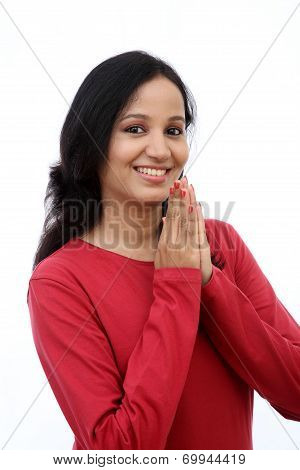 Young Woman Holding Hands In Prayer Position