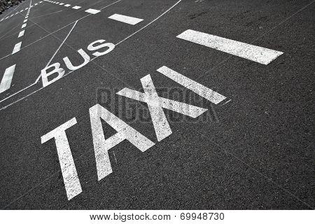Road marking on black asphalt of carriageway