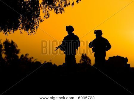 Soldier Silhouettes In Sunset