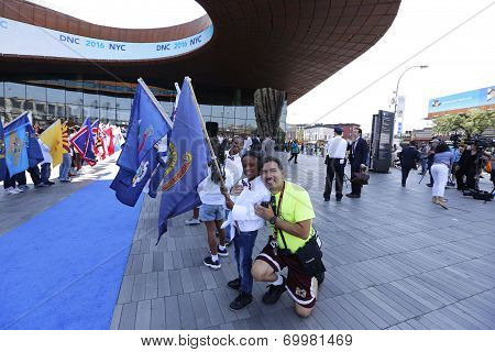 Kids with flags posing before Barclays Center