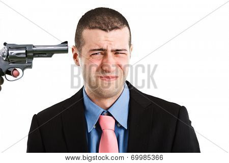 Businessman with a gun pointed to his head