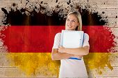 Mature student smiling against germany flag in grunge effect poster