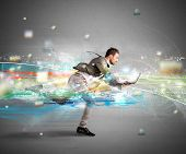 Concept of fast internet with running businessman with a laptop poster