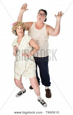 Funny Housewife Dancing in Front of Husband