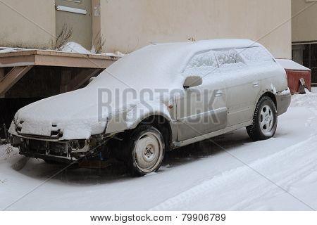 Snow Covered Broken Car