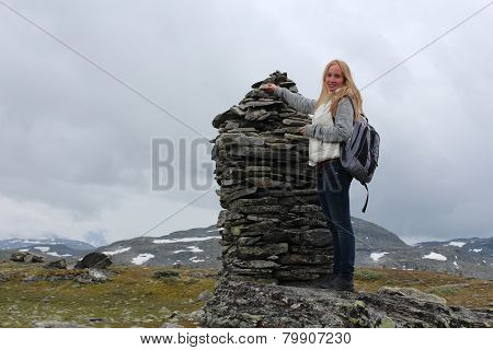 Young blonde woman on the glacier. Mountain in Norway.