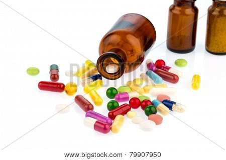 many tablets with a glas. photo icon for addiction and costs in medicine and medicines.