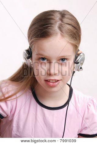 Girl Child, Studio Closeup Portrait With Headphones