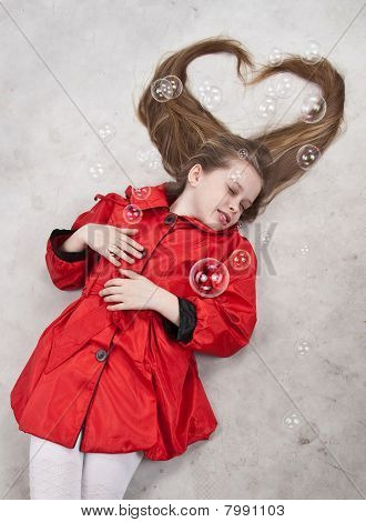 Beautiful Lying Young Girl With Long Blond Hair And Red Dress, Soapbubbles, Aries, Studio