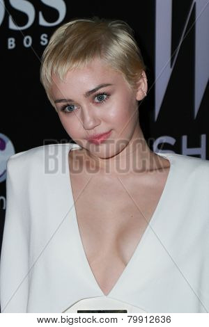 LOS ANGELES - JAN 9:  Miley Cyrus at the W Magazine`s Shooting Stars Exhibit at the Old May Company Building on January 9, 2015 in Los Angeles, CA
