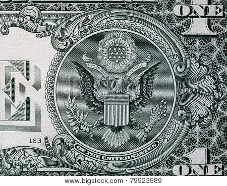 The Seal of The United States with E Pluribus Unum motto on the reverse side of one American dollar bill. USD