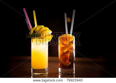 Screw Driver And Cuba Libre Cocktails In A Tall Glasses