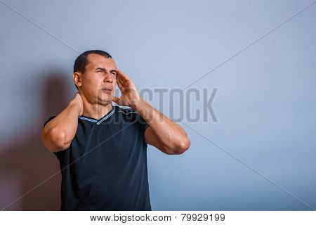 male of European appearance brunet put hands on his head, ma