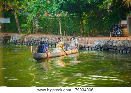 Alleppey, India - February 23: An Unidentified Man And A Women In Traditional Boat Are Sailing From