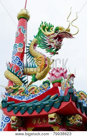 Dragon Winding Around The Pole In Chinese Shrine In Thailand
