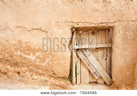 Rustic Door And Adobe Wall