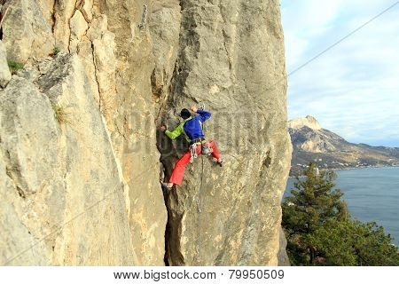 The rock-climber during rock conquest.Climber.Young  climbing in the Dolomits. poster