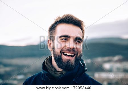 Portrait of laughing handsome man with a beard