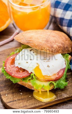 Burger with pouched egg and tomato for breakfast poster
