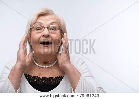 Portrait of lovely grandmother surprised