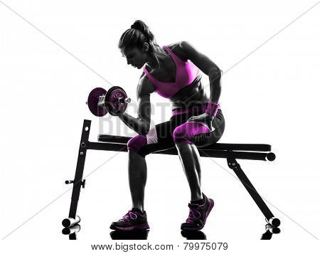 one caucasian woman exercising   weights body building fitness in studio silhouette isolated on white background