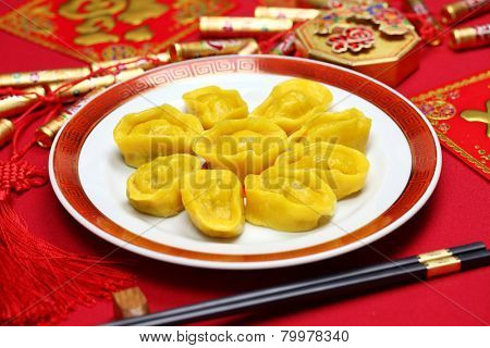 homemade chinese gold ingot dumplings, new year food, spring festival food  poster