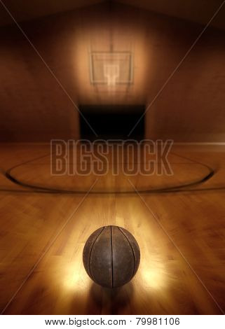 Basketball on floor of empty basketball court poster
