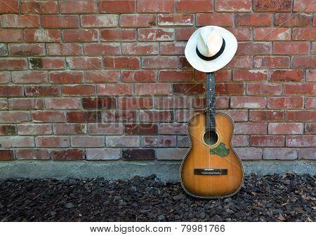 Musician Takes A Break - Guitar, Harp And Panama Hat