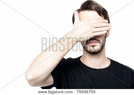 Man Making See No Evil Gesture