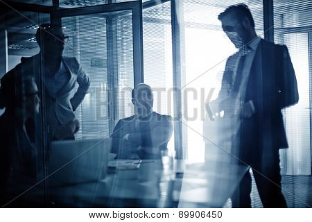 Business team consulting or planning work at meeting